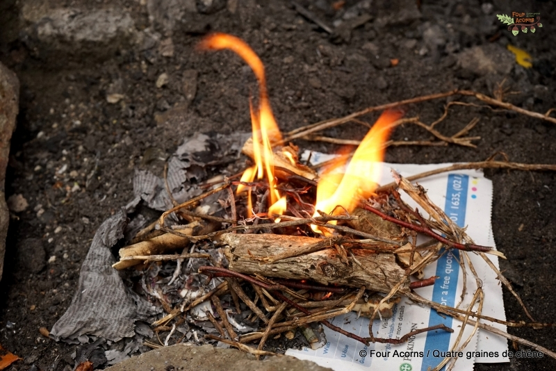 camp-fire-outdoors-flames-twigs-newspaper