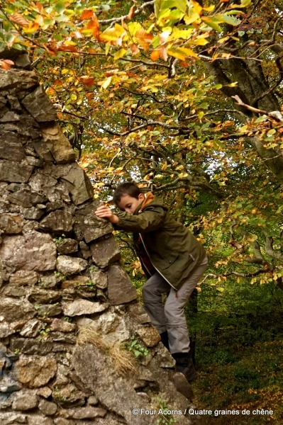 Otagon-boy-climbing-wall-ruins-autumn