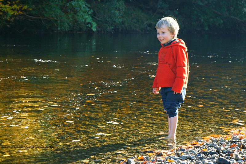 boy-barefoot-dipping-water-river