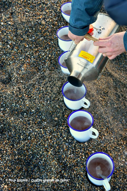pouring-hot-water-kelly-kettle-cups-hot-chocolate