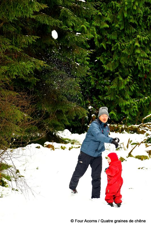 father-son-snowball-fight-fir-trees