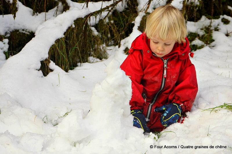 child-red-playing-snow