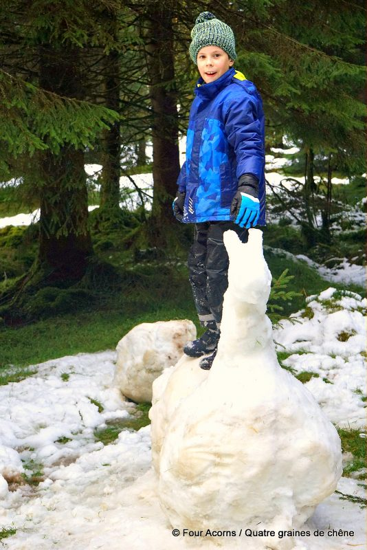 snow-horse-child-in-blue-standing-