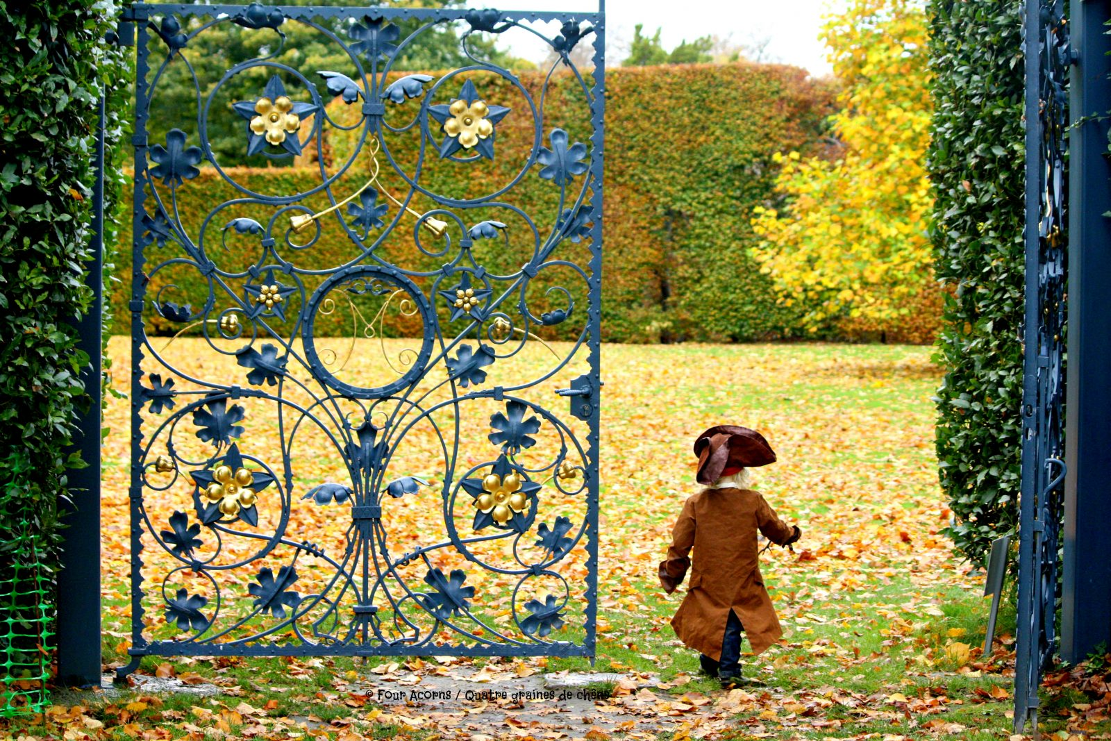 autumn-gardens-Wicklow-boy-costume-walking-through-blue-gate