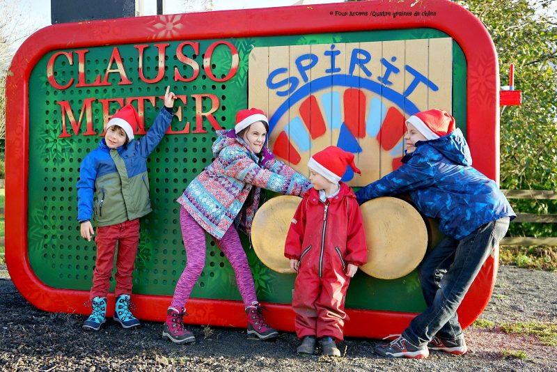 four-children-activating-clauso-meter-Christmas-spirit