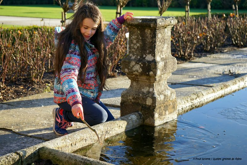 powerscourt-walled-garden-girl-plays-ice-sheet