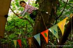 child-climbing-tree-birthday-banner