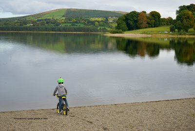 boy-cycling-beach-Blessington-lake-Wicklow