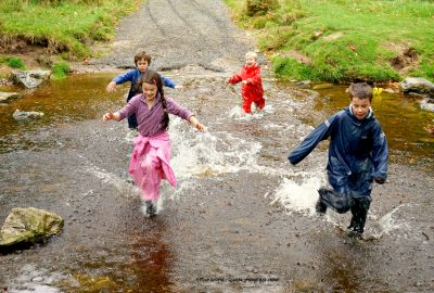 four-children-running-across-river