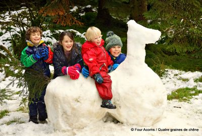 four-children-snow-horse-sculpture