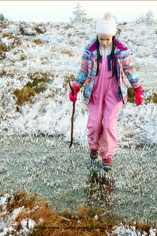 girl-pink-winter-clothes-stick-walks-on-ice-pool-wicklow