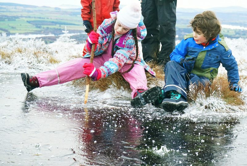 boy-and-girl-break-ice-pond-with-stick-wicklow-winter