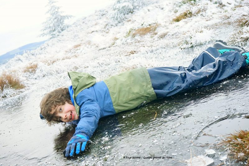 boy-slides-on-belly-on-ice-smile-wicklow