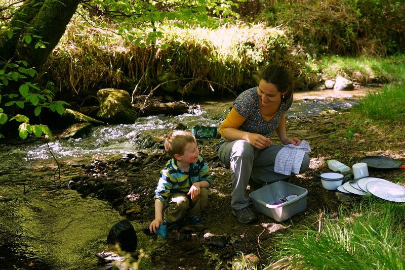 mother-son-washing-up-stream-river