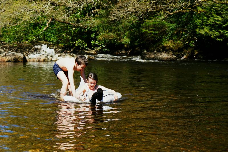chilren-playing-river-avonmore-wicklow-ireland