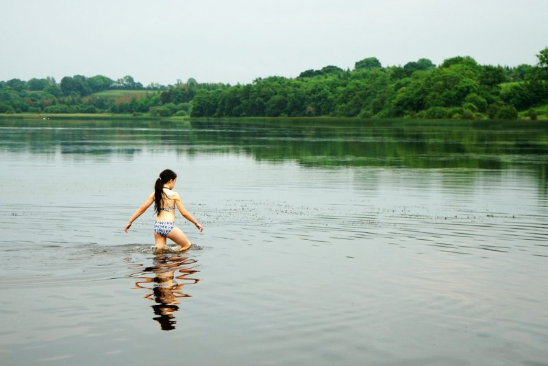 lough-oughter-girl-water-reflection