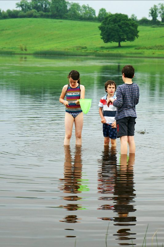 lough-oughter-three-children-pond-dipping-row-campsite