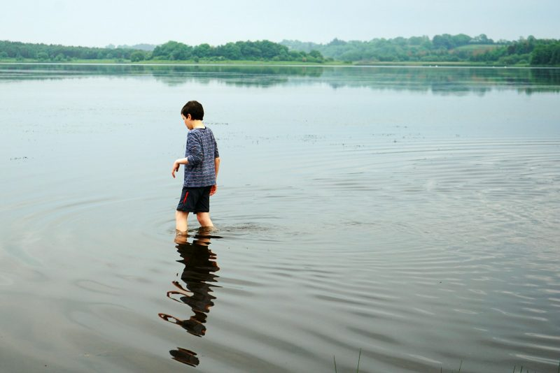 lough-oughter-boy-wading-in-row-campsite
