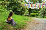 girl-footpath-Tibetan-prayer-flags