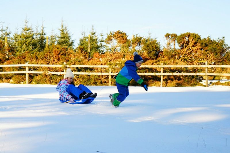 sledding-children-snow-field-sleigh-wicklow-ireland