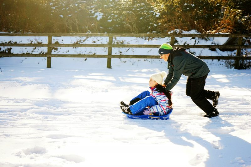 sledding-father-daughter-sleigh-sunshine-winter-wicklow-ireland